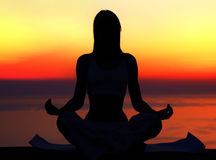 yoga-woman-over-sunset-19900488